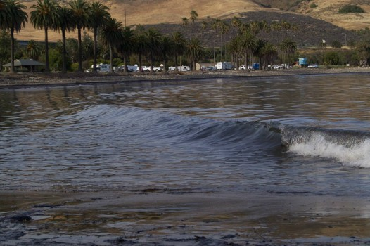 Black waves at Refugio State Beach North of Santa Barbara. A 24-inch ruptured pipeline leaked 21,000 gallons of oil into the Pacific Ocean (Photo Courtesy: Tamlorn Chase)
