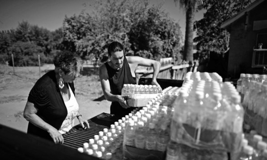 Volunteer helping distribute water