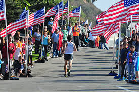 The Final Mile lined with people and American Flags to cheer runners on