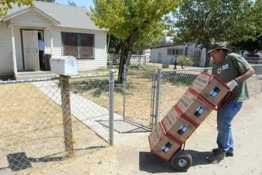 Local Porterville volunteer delivering water to residents without it.
