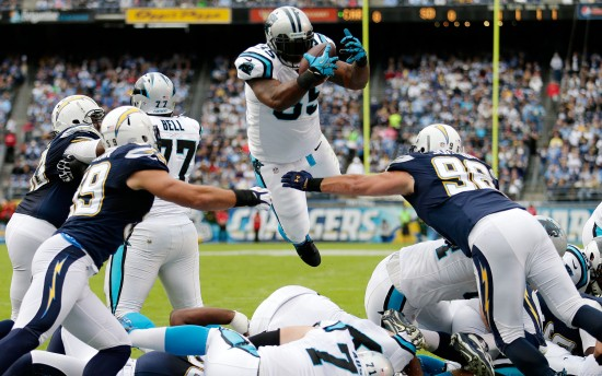 Carolina Panthers fullback Mike Tolbert scores against the San Diego Chargers  during the first half of a NFL football game Sunday, Dec. 16, 2012, in San Diego. (AP Photo/Gregory Bull)