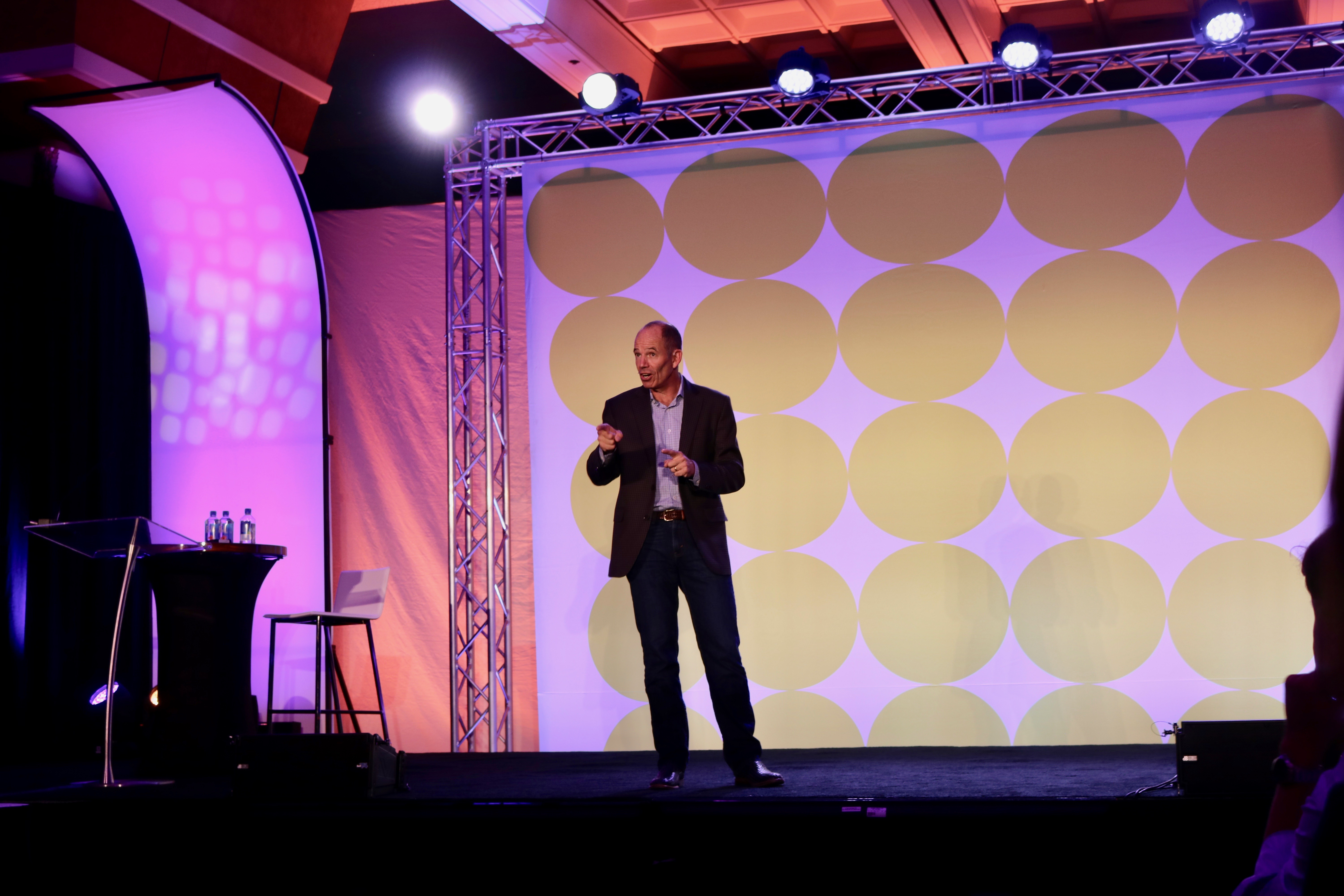 Marc Randolph, the Co- Founder of Netflix, speaking on the main stage at ONTRApalooza 2016.