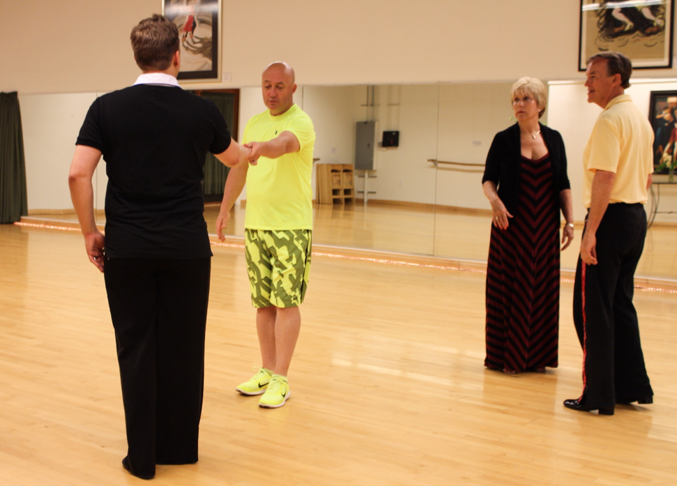West coast swing instructor Jamie Bayard demonstrates the females' steps together with dancer Nigel Clarke.