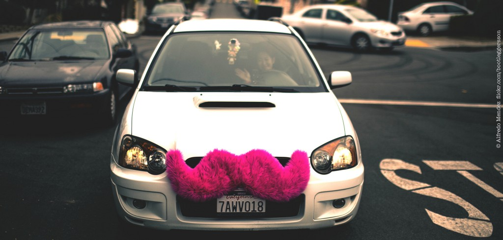 Lyft car with the signature pink moustache