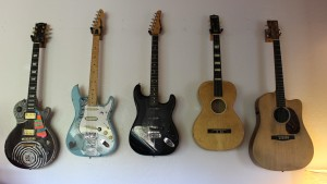 FMLYBND's guitar wall.