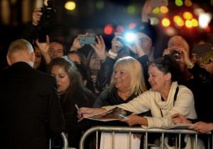Fans receive autographs from Michael Keaton as he arrives.