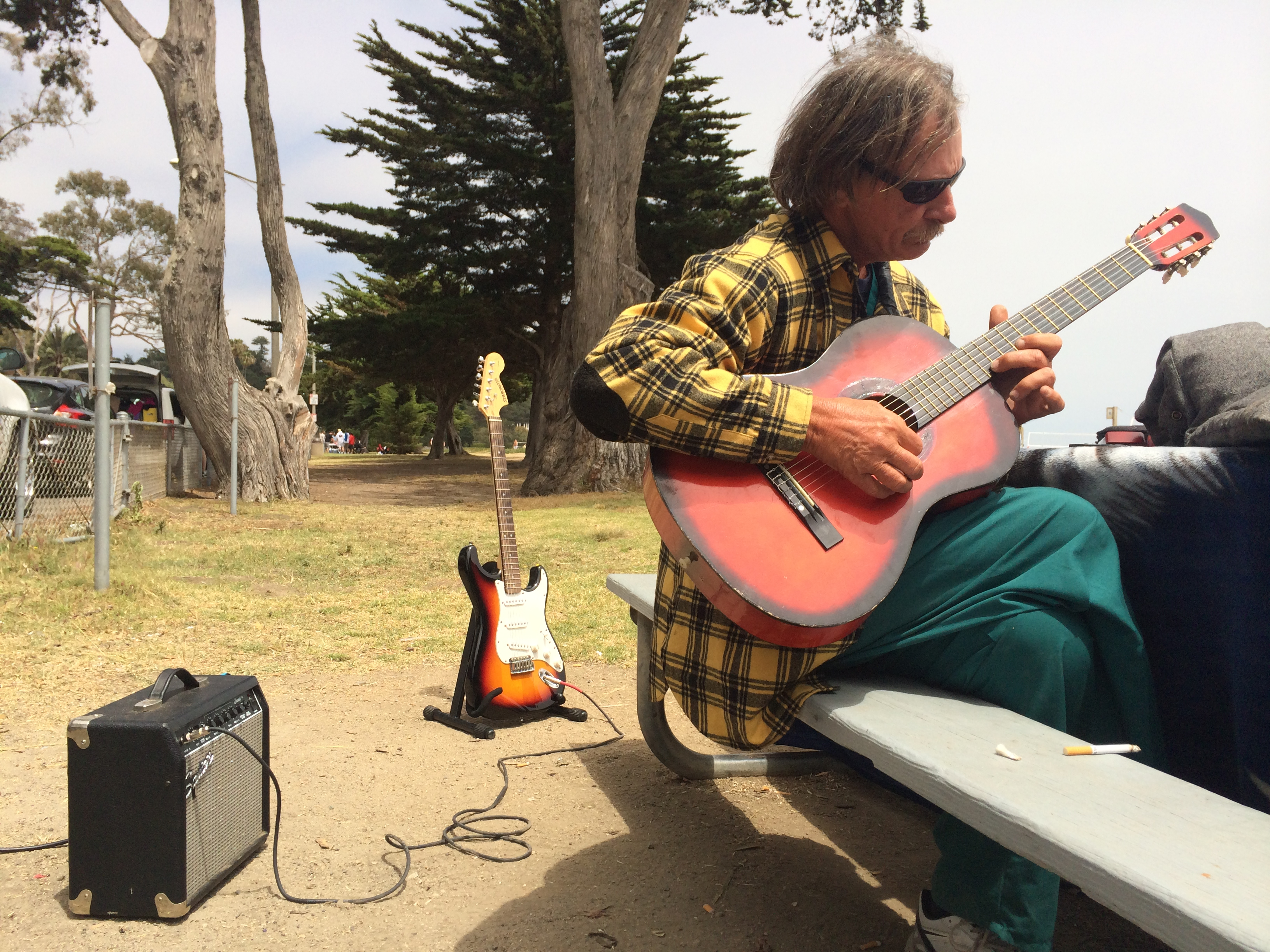 "Larry, with two old blues guitars, posted at East Beach, Santa Barbara. Different styles of blues in different guitars, each with their own attributes. ""I'm just an underground blues player, living out of my care and playing the blues for people that matter"" -Larry  -David Arnet"