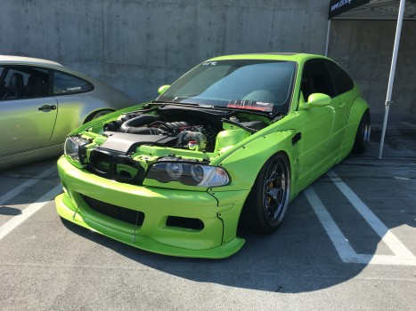 A modified Green BMW parked in the car show. Is it legal to drive on the road?